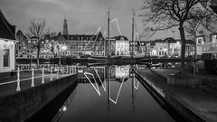 Homeward Bound (McQuaide Photography) Tags: haarlem noordholland northholland netherlands nederland holland dutch europe sony a7rii ilce7rm2 alpha mirrorless 1635mm sonyzeiss zeiss variotessar fullframe mcquaidephotography lightroom adobe photoshop tripod manfrotto light licht water reflection stad city urban waterside lowlight architecture outdoor outside waterfront building longexposure blackandwhite blackwhite bw mono monochrome river spaarne riverside pegasus boat ship schip boot zeilboot sailboat traditional authentic night nacht nightphotography illuminated mast moored mooring 169 widescreen spaarnwouderbuurt
