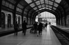 Waiting at a train station (Nikos.K.) Tags: 2018 trainstation people piraeus πειραιάσ greece blackandwhite ασπρόμαυρο film 135 homebrewdeveloper expiredfilm fp4 ilford ei200 d76 olympusom2n zuiko 50mm18