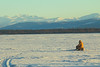 Ice fishing with a view (Lyle Nel) Tags: water ice snow fishing view mountains cold jacket yellow vista landscape siberia russia lakebaikal icefishing fisherman offthebeatenpath secluded