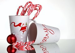 Red & White Christmas (Karen_Chappell) Tags: red white christmas noel holiday xmas stilllife candy candycane ornament bauble mug cup reflection santa santaclaus