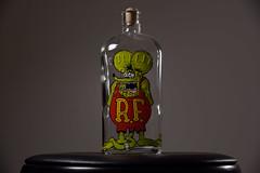Rat Fink Bottle (. o 0 Sam 0 o .) Tags: nikon d750 24‑120mmf40gedvrafs yn660 yongnuo sb600 speedlight flash strobist bottle glass ratfink rogue unedited whitebackground whitewall