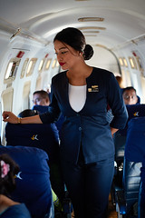 Nepali Air hostess on touristic mountain flight, Nepal (Alex_Saurel) Tags: airplane asia culture work photoreport lifescene passengers stewardess asian day reportage hotessedelair siègespassager scènedevie travel 35mmprint people aircraft nepal hublots airhostess photospecs action hôtessedelair imagetype passagers aircraftinterior motif passengerseats asie lifestyles photojournalism cabincrew aicraftcabin scans stockcategories pattern window avion time photoreportage transportation airattendant sony50mmf14sal50f14