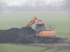 It's A CASE Of Digging The Dirt (Gary Chatterton 4 million Views) Tags: case digger field dirt muck agriculture countryside mist excavator yellow canonpowershot photography amateur flickr explore steaming