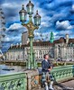The bellowing bagpiper can be heard clear across the Thames. (Fotofricassee) Tags: westminster thames bagpipes eye london