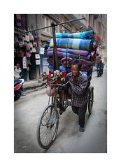 The strain captured in his face. (posterboy2007) Tags: kathmandu nepal porter rugs street tricycle sony