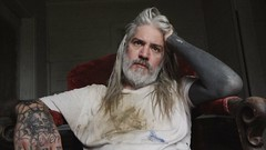 23275456_286308768541518_5298389362623933601_o (josephinehennessey) Tags: man sit chair ponder think confused dirty white shirt long hair musician