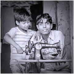 Together (Pejasar) Tags: boy man father son sewing machine work job family bw blackandwhite delhi india