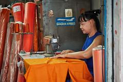 Sewing a monk's robe (Thomas Mülchi) Tags: phranakhondistrict bangkok thailand 2017 person woman sew sewing sewingmachine monksrobes orange saffroncolor krungthepmahanakhon th