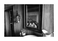 Awakening (Jan Dobrovsky) Tags: udokier portrait leicaq monochrome mirror slovakia people room blackandwhite thepaintedbirdmovie oldhouse awakening indoor document