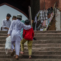 Friendship at prayer time (Pejasar) Tags: jama masid jamamasidofdelhi delhi india twoboys stairs climb prayertime friendship carryingprayermat mosque olddelhi sandals redshirt