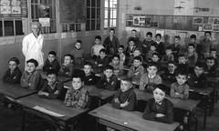 Arms Folded (theirhistory) Tags: boy child kid teacher desks coats classroom