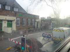 Storm Eleanor at Acocks Green Station - roadworks outside The Great Western (ell brown) Tags: acocksgreen birmingham westmidlands england unitedkingdom greatbritain acocksgreenstation yardleyrd yardleyrdacocksgreen chilternmainline moorstreetdorridgeline moorstreettodorridge sherbournerd chilternrailways chilternrailwaysmainline westmidlandstrains westmidlandsrailway stratforduponavontostourbridgejunctionviadorridgeline stormeleanor bus 11c nxwm nationalexpresswestmidlands roadworks thegreatwestern pub publichouse trafficlight rain raining