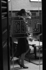 waitress, Consulate, Surabaya, Indonesia (Plan R) Tags: consulate surabaya restaurant bar evening dark woman movement monochrome blackandwhite leica m 240 noctilux 50mm door