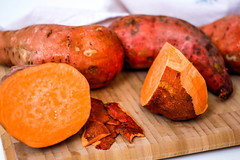 Sweet Potatoes on a Cutting Board (wuestenigel) Tags: sweet potato vegetable food fresh root healthy raw lebensmittel noperson keineperson meat fleisch delicious köstlich dinner abendessen beef rindfleisch pork schweinefleisch meal mahlzeit nutrition ernährung cooking kochen sausage wurst grow wachsen gemüse lunch mittagessen plate teller wood holz barbecue grill fruit obst juicy saftig tasty lecker