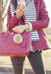 gray and white striped scarf, red quilted jacket, gold watch, purple red tote with fur pom keychain, white sweater with lace hem, black jeans (brightenday) Tags: outfit coldweather jacket color stripes pattern scarf fur sweater lace pants watch