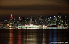 Christmas Night (james c. (vancouver bc)) Tags: longexposure cloud smooth water reflection holiday night evening christmas downtown skyscraper metropolitan apartments lamp travel view canada waterfront urban landmark highrise skyline port ship dusk glow building modern vancouver architecture city color colorful panorama sky scenic sea lamplight container crane office nighttime illuminate inlet lights landscape harbor cityscape colour harbour