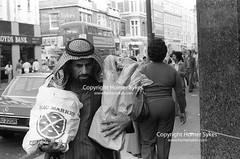 ARABS FOOD SHOPPING EARLS COURT LONDON 1970's ENGLAND (Homer Sykes) Tags: arabs middleeastern london poor healthcare tourism healthcaretourists archivestock muslim uk british society england english britain archive archival 1970 1970s people person myref313083 1977 70s gbr