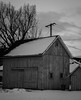 weathered barn (abbigail may) Tags: monochrome winter weathered barn door windows cloud tree snow melting
