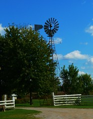 HFF-down on the farm (Explore!) (SCOTTS WORLD) Tags: adventure america angle fun fall fence field hff historic green grass gravel greatlakesstate trees blue bluesky clouds country rural turbine grandpastinyfarm frankenmuth michigan midwest panasonic pov perspective park october 2016