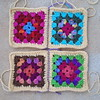 Two rows of two granny squares each ready to be joined (crochetbug13) Tags: crochetbug crochetsquares grannysquares crochetblanket crochetafghan crochetthrow roseanne roseannereboot roseannesofablanket crocheted crocheting scrapyarn yarnstash