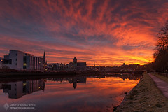 Red sky over Drogheda and the Boyne (mythicalireland) Tags: red sky morning dawn twilight clouds golden flame river boyne reflection churches bridge drogheda louth trees courthouse millmount landscape