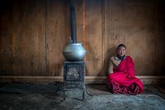 Solitude (gheckels) Tags: bhutan solitude monk portrait portraiture bhuddism bhutantravelphotography gangtey red pot kitchen solo environmentalportrait fireplace winter heckelsphotography sonya7rii sonyimages
