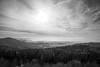 What now? (Raphs) Tags: bavaria bavarianforest bayern bayerischerwald hirschenstein outlook view scenery landscape sky thin clouds sun monochrome blackandwhite wood forest mist raphs canoneos70d canonefs1585mmf3556isusm elevatedviewpoint