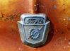 Ford (J Wells S) Tags: ford hoodornament logo emblem rust rusty crusty junk fastiquesrodcustomcarclub pumpkinrunnationalscarshowandswapmeet clermontcountyfairgrounds owensville ohio