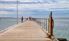 Clouds over the pier (Greenstone Girl) Tags: mordiallocbeach sand summer beachumbrella clouds heathaze pier seagulls sky