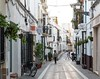 Walking in Downtown Rota (thedailyjaw) Tags: spain europe d610 nikon 85mm streetphotography european architecture street alley people spanish rota downtown explore visit see travel plants grid locals