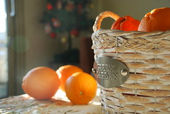 My production (jimiliop) Tags: oranges fruits basket stilllife home indoor christmastree tabletop letters light natural noediting bright window bokeh flare