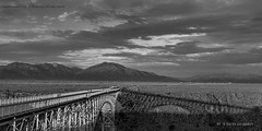 Rio Grande Gorge Bridge-02 (jamesclinich) Tags: newmexico nm taos riograndegorge bridge mountains sky clouds landscape canyon handheld availablelight jamesclinich olympus omd em10 adobe photoshop topaz denoise detail clarity bweffects blackwhite monochrome
