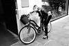 Paris, rue du Faubourg Saint Honoré 2017 (hp chavaz) Tags: france 2017 paris subject street woman bicycle xpro2 ruedufaubourgdutemple prime xf23mmf20 fujifilm monochrome fuji bw