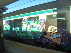 477 (en-ri) Tags: rotels uao crew ragazzo boy guy verde arrow nero lilla train torino graffiti writing testa head