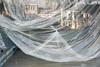 suspended 13 (godelieve b) Tags: vitrine fenêtre window shop reflection reflet reflect tissu plastic plis travaux work ensuspens suspended abstraction