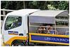 """Hi Guys"" - Singapore (TravelsWithDan) Tags: children hi truck streetportrait singapore outthebuswindow street canong15 city urban outdoors"