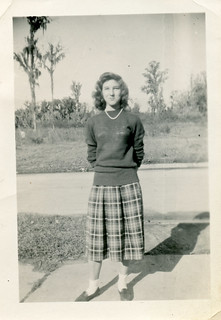 Woman in Sweater & Plaid Skirt Posing by Street, 1940s