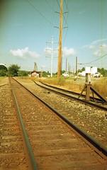 Rail past the feed store (rentavet) Tags: analog olympusstylus80 grovecitypa ferrania100asa