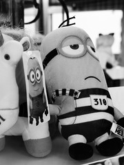 Happy/sad (tishpitt1) Tags: minions despicableme toy shop store plush humor funny irony monochrome blackandwhite panasoniclx7