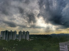 fight between the Sun and Clouds (tomquah) Tags: sunrays cloudy clouds sky nature landscape singapore lowerpeircereservoir tomquah hdr