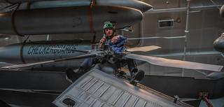 U.S. Navy Sailor works on helicopter.