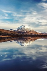 two mountains, two moons, at the meeting of two years (caoimhinoraghallaigh) Tags: canont3i canon600d canon t3i 600d olympus zuiko 35mm f28 olympuszuiko35mmf28 ireland irish donegal lake river water reflection nature outdoors landscape natural beauty manualfocus primelens prime manual
