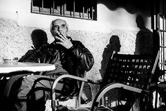 Lights and shadows (Roberto Spagnoli) Tags: light shadow bar smoke cigarette sun blackandwhite biancoenero monocromo fotografiadistrada streetphotography fujix100t italy