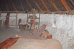 Iron Age Farmstead recreation - interior (cmw_1965) Tags: bryn eryr iron age farmstead hut settlement st fagans museum wales cymru welsh thatch thatched whitewashed mud floor shield boss sword wheat chest pestle mortar antlers weaving loom broom helmet armour spear pottery