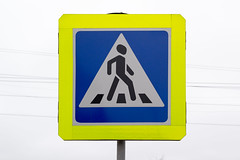 Road sign of a pedestrian crossing (Jess Aerons) Tags: symbol passage sign white zone road safety signal crossing stop background safe drive care beware city icon careful crosswalk street close caution way urban attention pedestrian walk through education roadsign path up traffic footpath sky town tree warn object crossover signpost line triangle colors public human black transport people photo