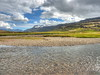 An Icelandic vista (Digidoc2 - BACK) Tags: river creek water pebbles stones mountains clouds sky lava moss grass snow summer landscape scenicbeauty vista iceland eastfjords valleyofthewaterfalls