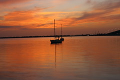 IN THE MORNING (R. D. SMITH) Tags: sunrise morning river boat orange florida reflection sky clouds shore indianriver melbourneflorida brevardcountyflorida mast sail sailboat dawn canoneos7d