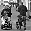 P1310936 (Akbar Simonse) Tags: holland netherlands nederland streetphotography straatfotografie people candid urban bicycle fiets fietser cyclist scootmobile scootmobiel zwartwit bw blancoynegro bn monochrome hat hoed cap pet vierkant square akbarsimonse