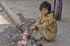Can you help me? (Pejasar) Tags: boy beggar dalit caste oppressed poverty poor child dirty clothes barefoot woundedfoot coke plasticbottle spigot waterfaucet ragged olddelhi india