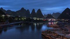 Pre-dawn on the Li River (tmeallen) Tags: predawn bluehour karstmountains longexposure reflections citylights tourboats liriver lijiang guangxiprovince china